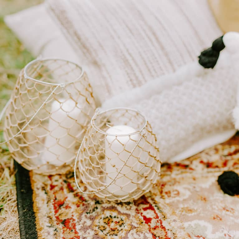 Outdoor Candles and Pillows on a Rug