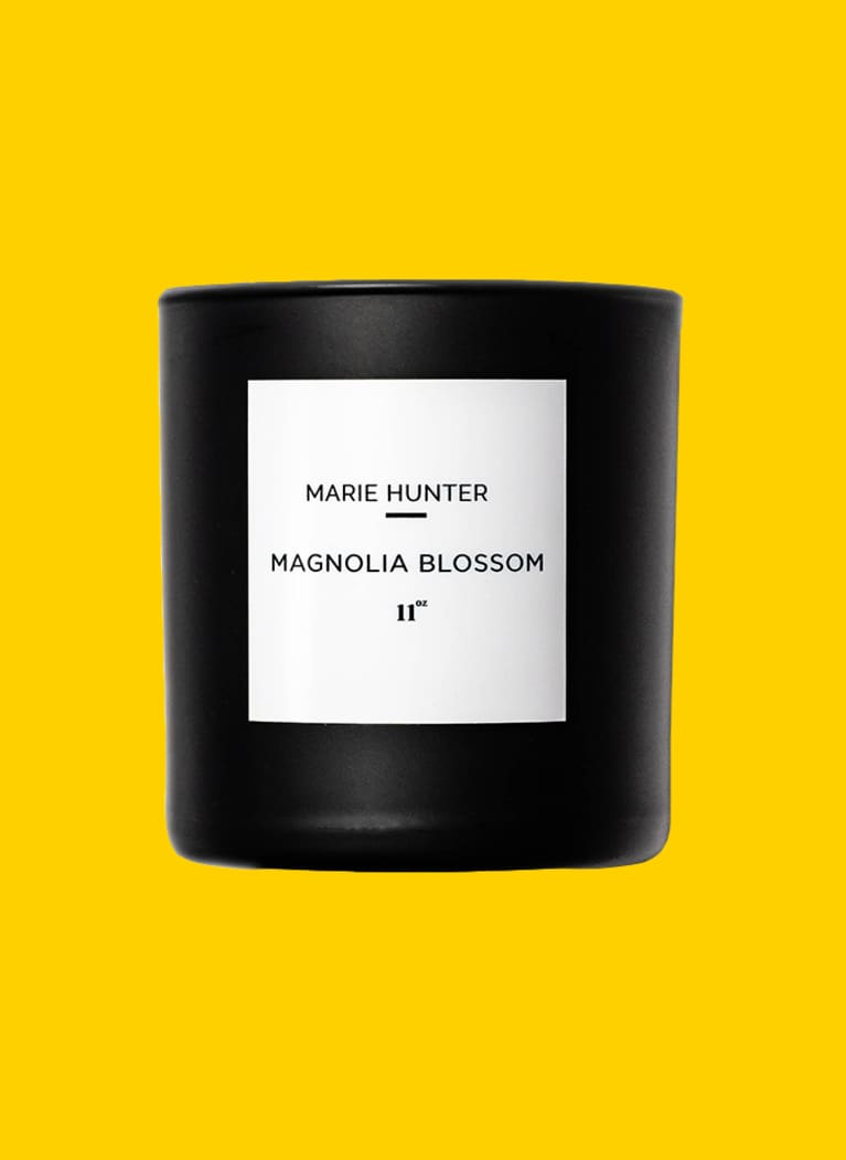 Marie Hunter Magnolia Blossom candle in black container