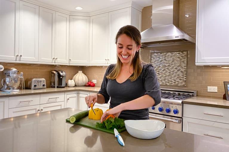 Jourdan Buchler cutting vegetables in a kitchen