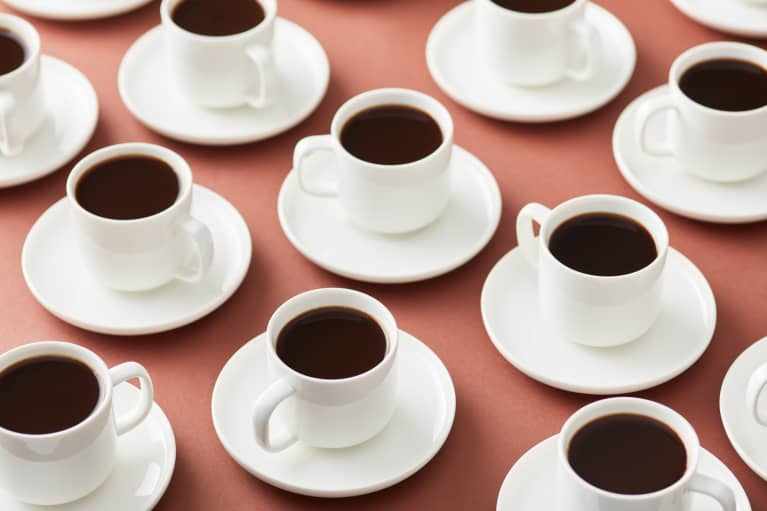 Multiple Cups of Coffee on Saucers