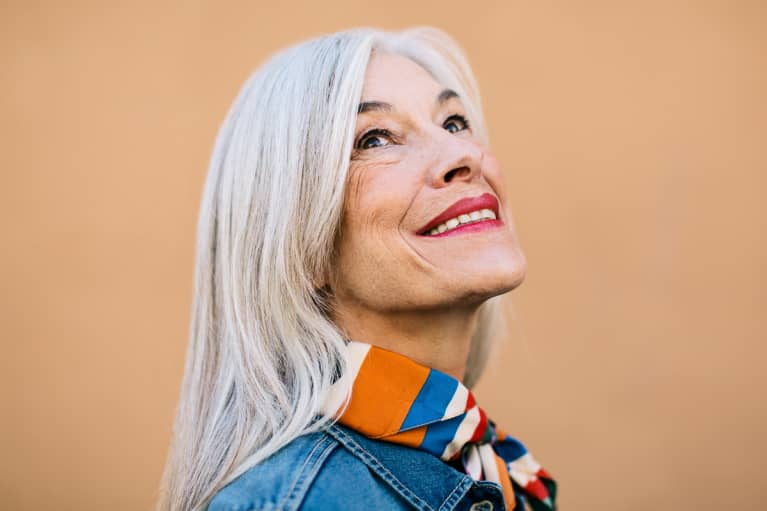 Portrait of a Woman in Her 60s Smiling and Looking Up