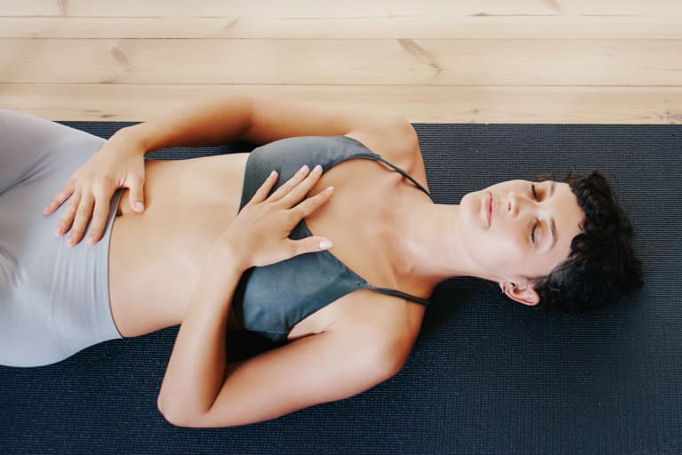 Woman Lying on the Floor Doing Diaphragm Exercise