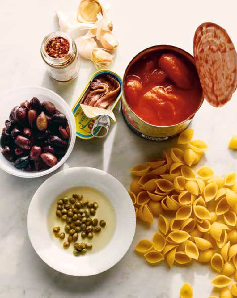 Olives, sardines, canned tomatoes, pasta, capers, chili flakes, Garlic