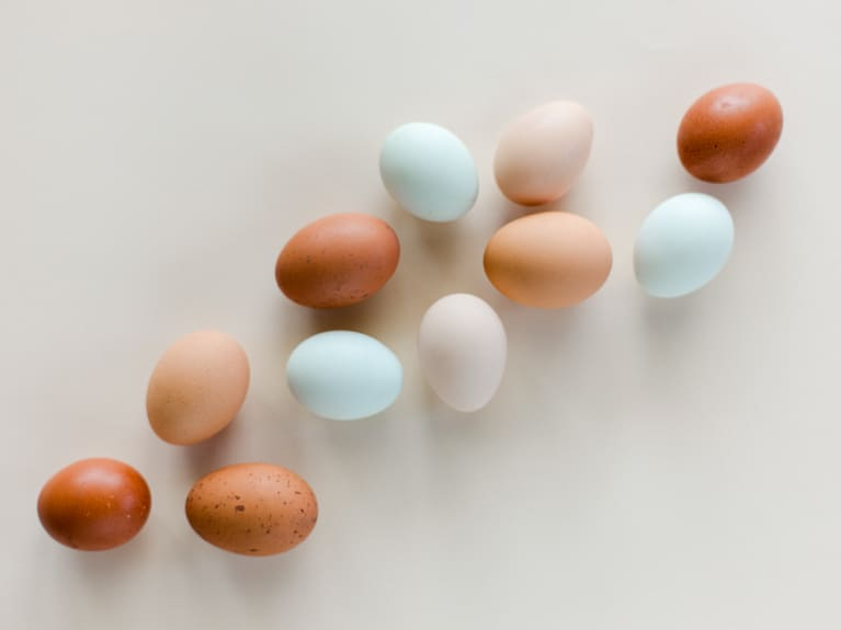colorful eggs sorted by color into an ombre pattern