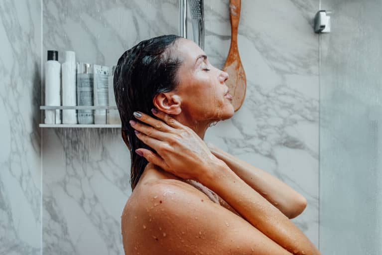 Woman Enjoying Fresh Water In Shower