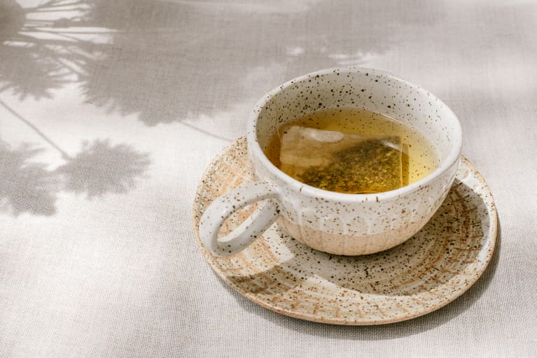 A cup of fresh tea at a picnic outside