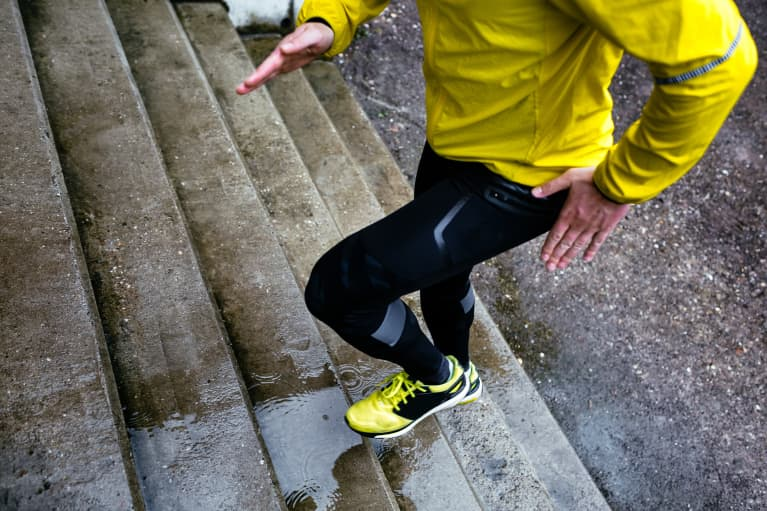 Athlete Climbing A Wet Staircase On A Rainy Day