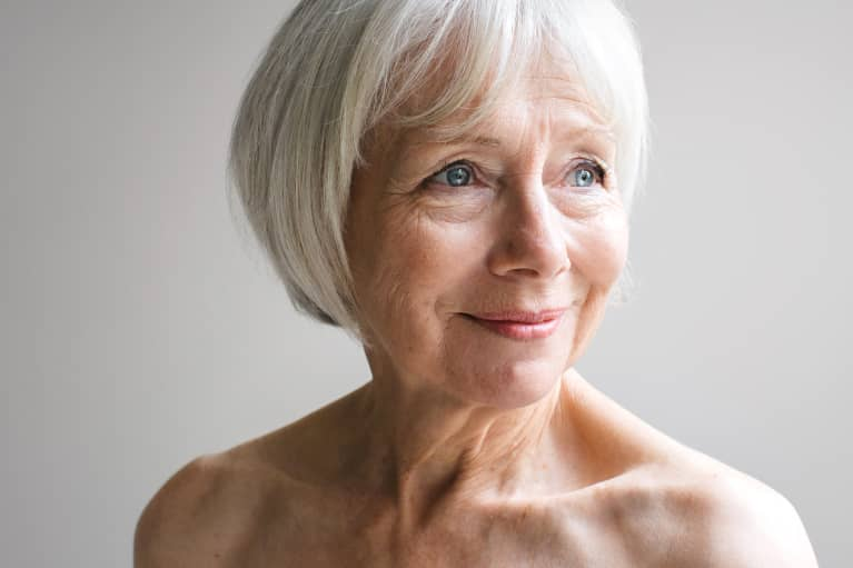 Older woman with gray hair on a white background