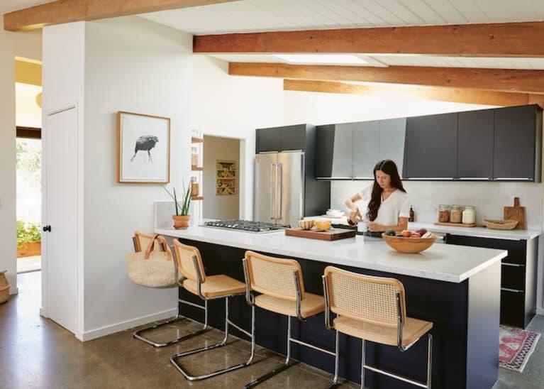woman cooking in sleek sustainable kitchen