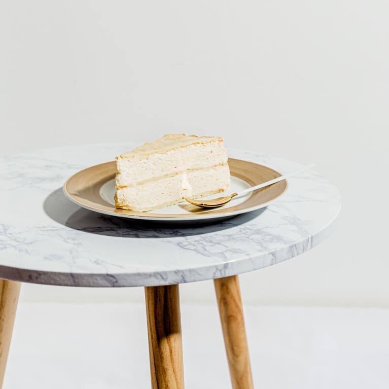 Slice of White Layer cake on a Plate in a Minimal Setting