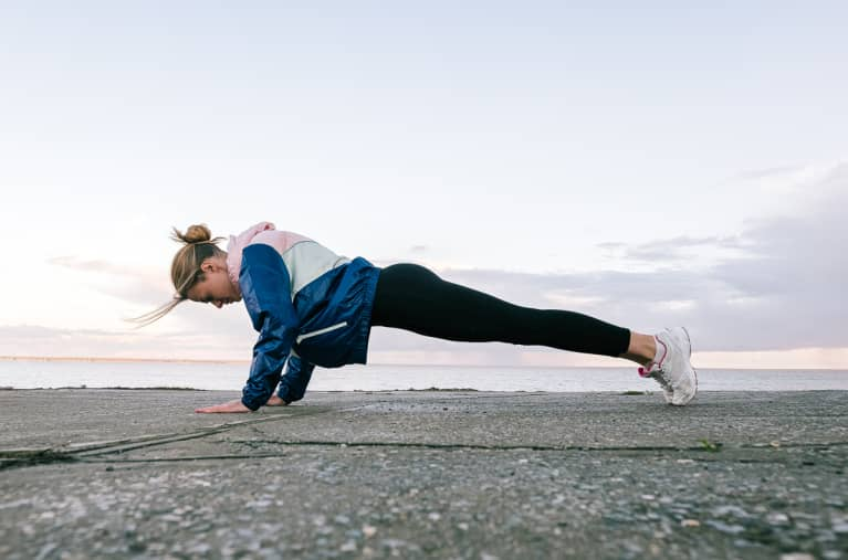 Strong Sportswoman Doing Push-Ups On Asphalt