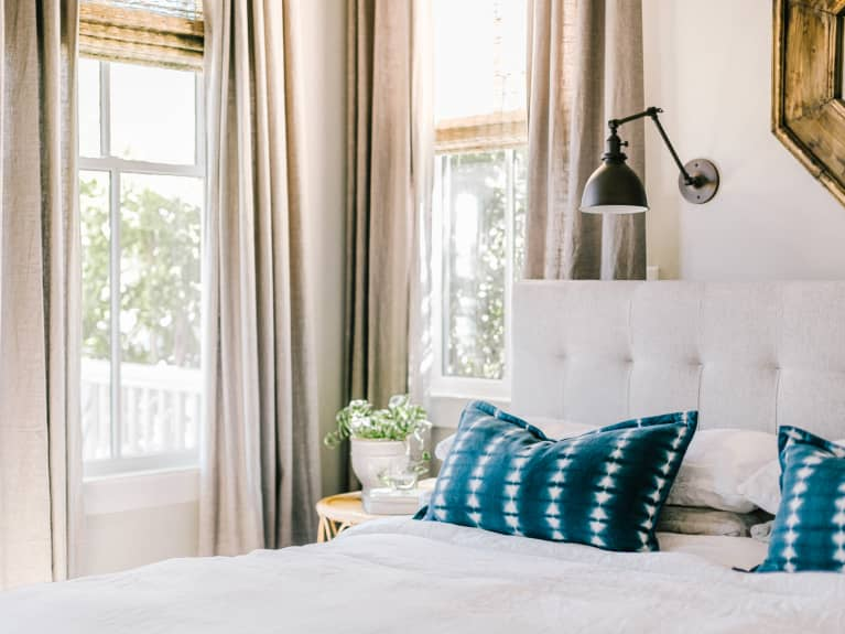 How To Position Your Bed For Better Sleep, According To Feng Shui