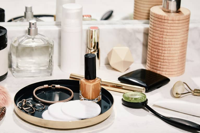 Makeup & Skincare Products on a Bathroom Counter - Nail Polish, Lipstick, Body Lotion Perfume