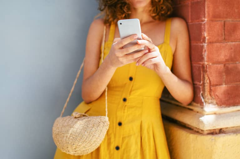 Woman in a Yellow Sundress Texting
