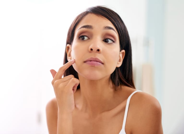 Step Away From The Mirror — One Dermatologist's Tip To Stop Picking