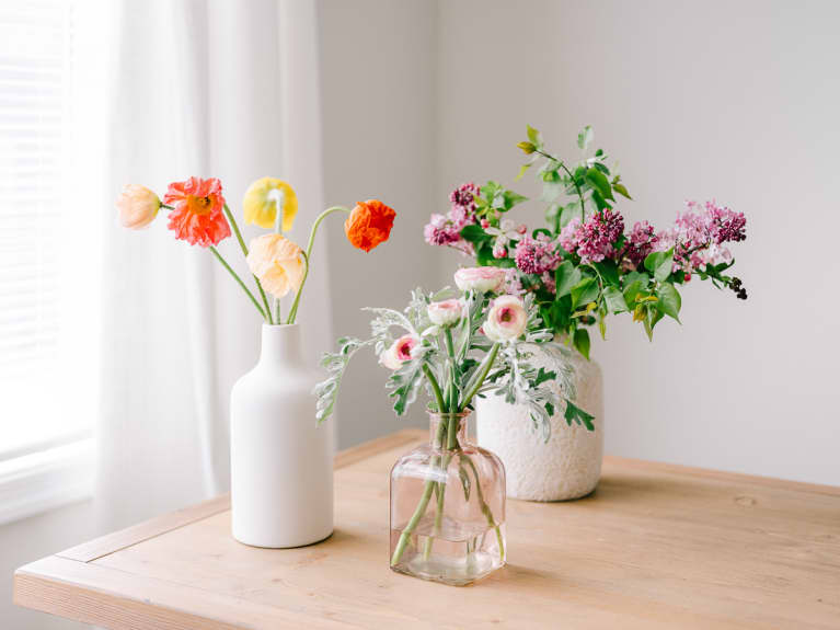 Fresh Spring Flowers in Three Vases On a Table