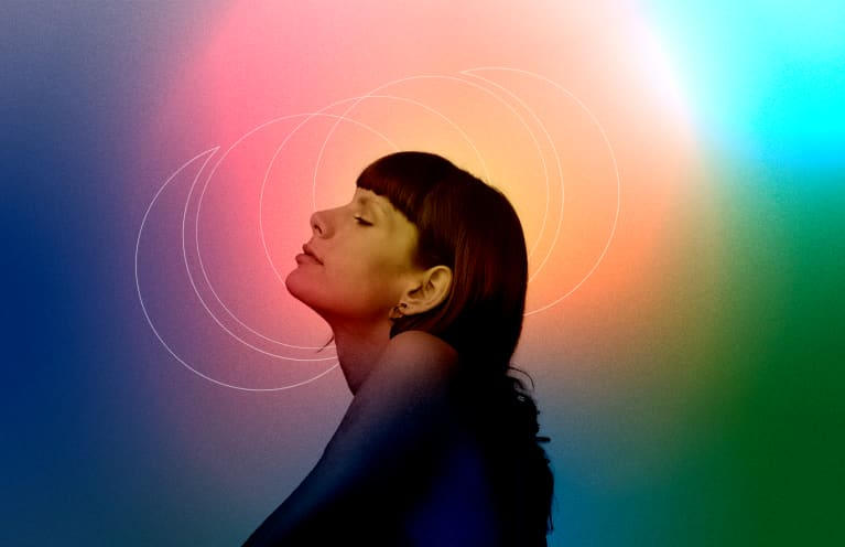profile of a woman in front of colorful, mystical background