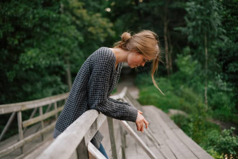 Upset Woman Looking Downcast on a Nature Path