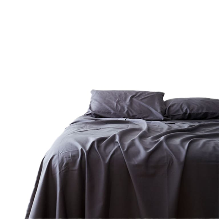 bed covered in dark sheets