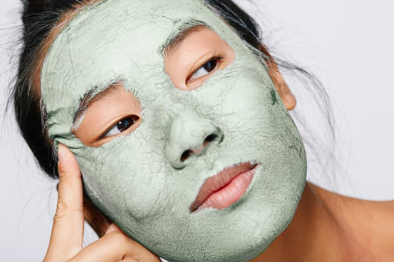 Young Woman with a Green Facial Mask