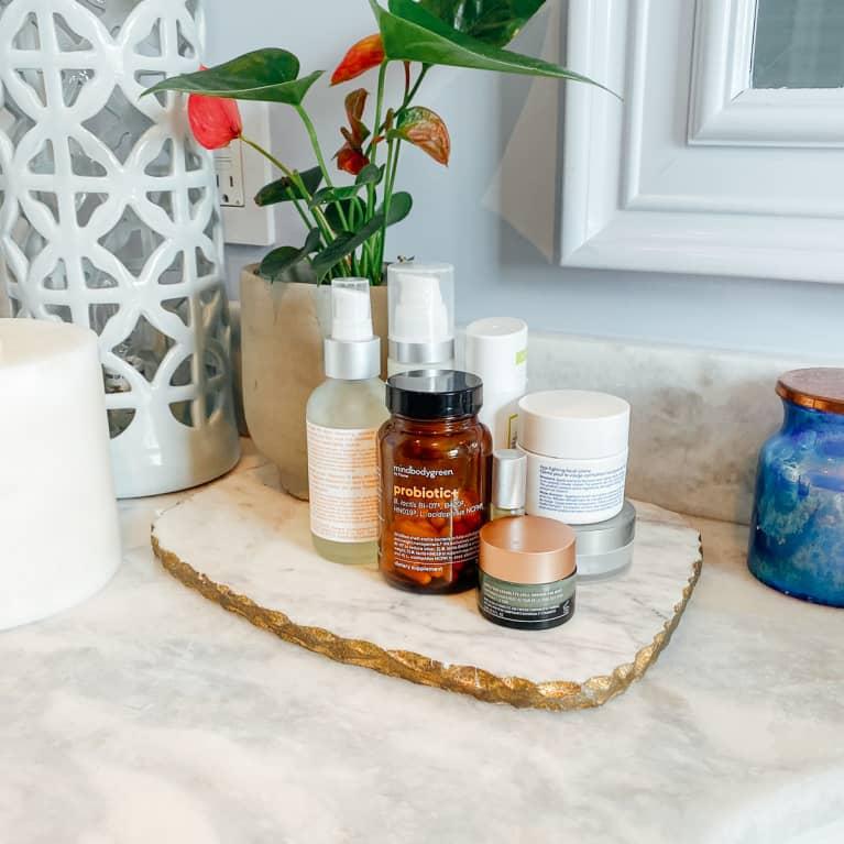 mindbodygreen probiotic+ on a bathroom counter