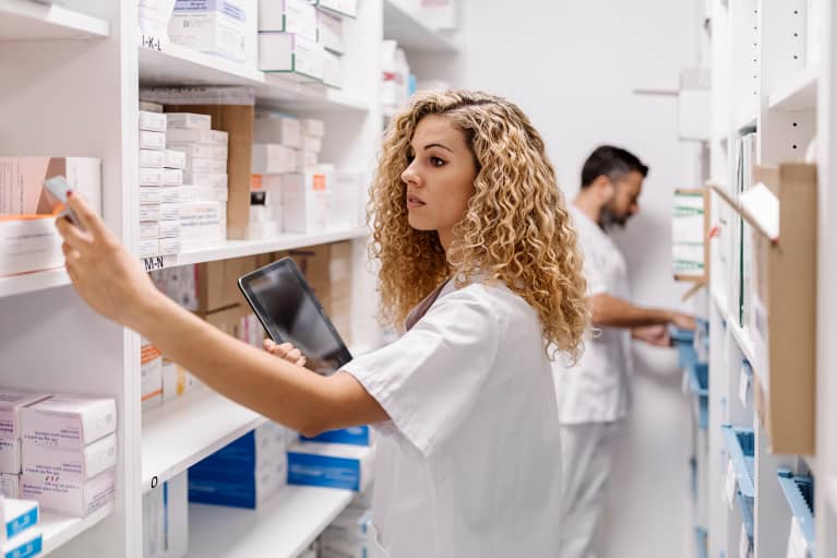 Medical worker with medicines and vaccines