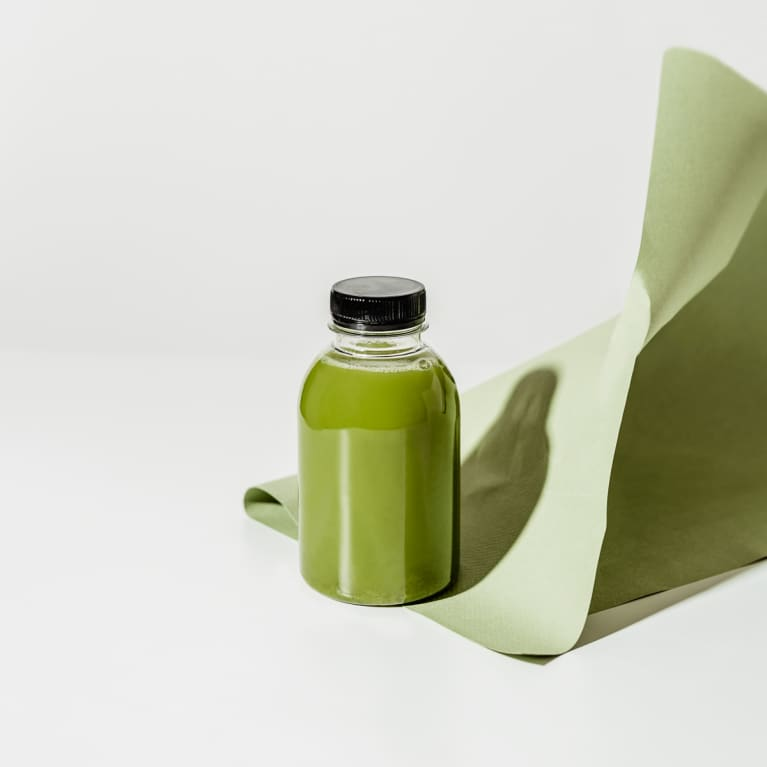 Bottle of Green Juice on a Seamless