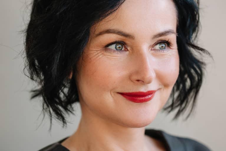 Closeup beauty portrait of mature brunette woman with short haircut