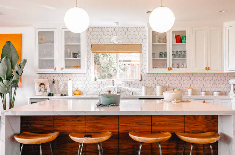 Clean Bright Kitchen with Large Island and Barstools