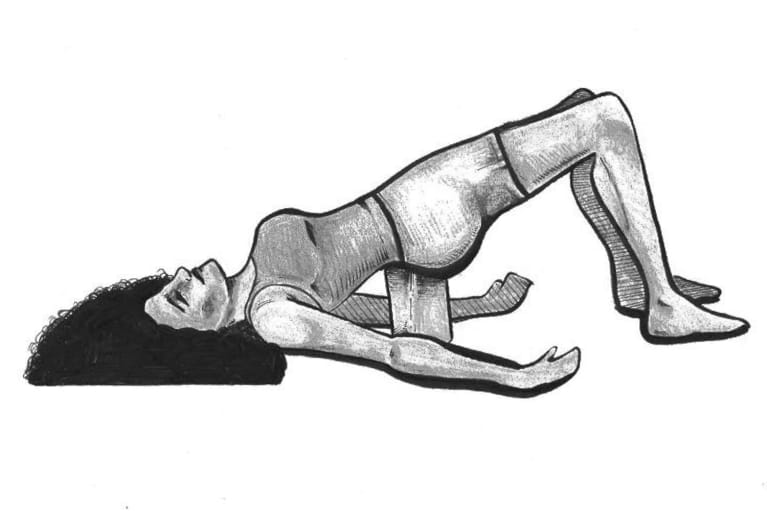 Supported bridge pose—Setu bandha sarvangasana