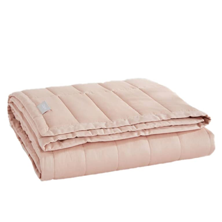 Folded, light pink weighted blanket from Casper.