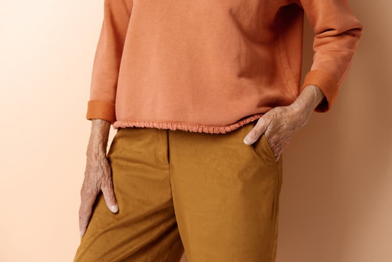 Close-up view of unrecognizable senior woman in elegant casual clothes, her hand in pocket