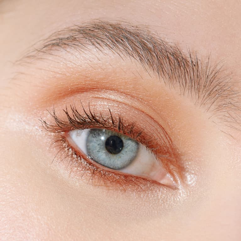 Closeup Shot of a Blue Eye with Soft Makeup