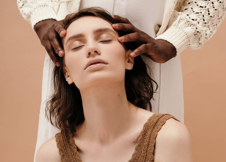 Woman receiving a relaxing scalp massage
