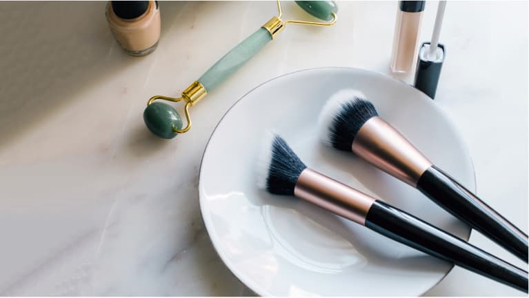 makeup brushes sitting on a pretty plate