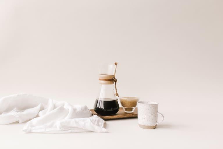 drip coffee maker set up with mug on platter