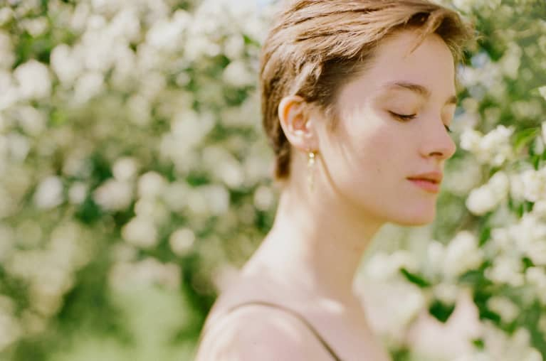 Peaceful Young Woman in Springtime