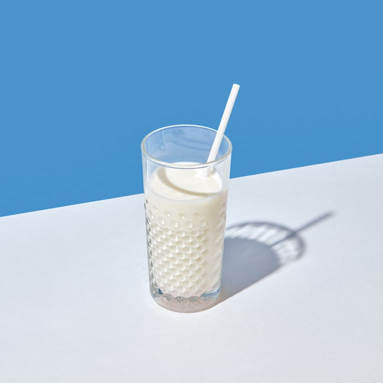 Glass Of Fresh Milk With Paper Straw