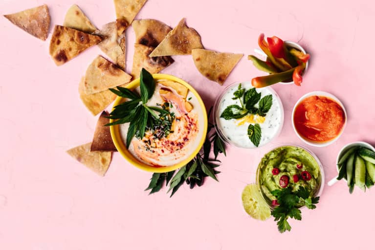 multiple dips and chips. Hummus, yogurt dip, guacamole