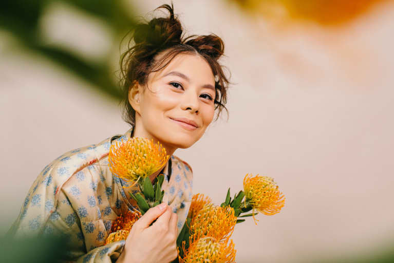 Happy Woman With Blooming Flowers