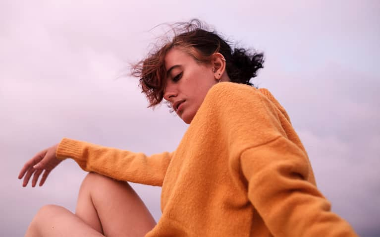anxious woman with orange sweater