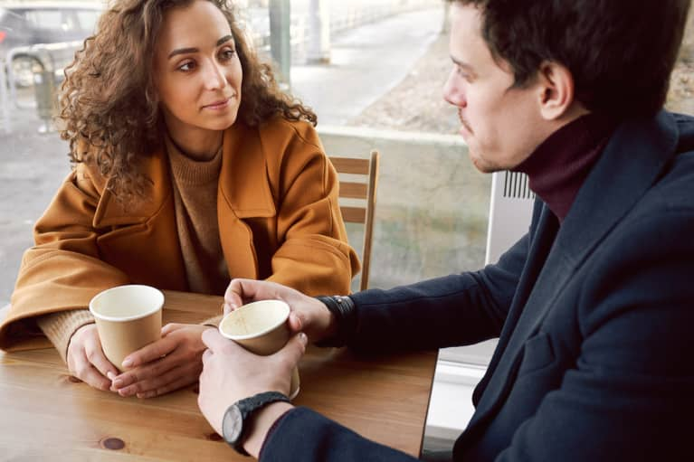 Man and Woman Talking in a Cafe