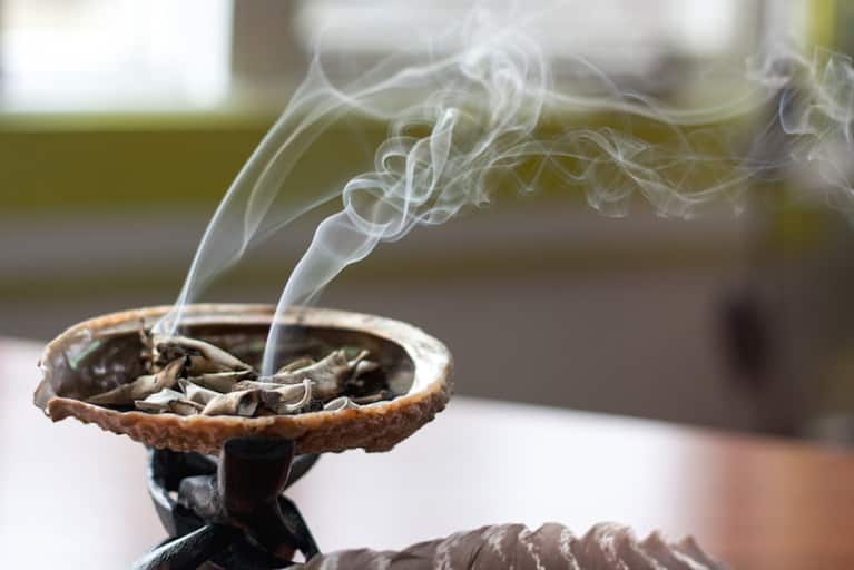 Smudging 101: Burning Sage To Cleanse Your Space & Self Of Negativity