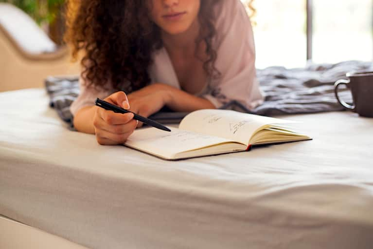Image of a person enjoying alone time by journaling.