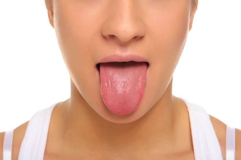5 Reasons Why Everyone Needs A Tongue Scraper