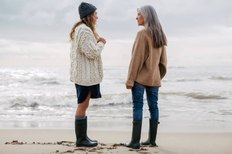 Mother and Daughter Talking on a Cloudy Beach Day