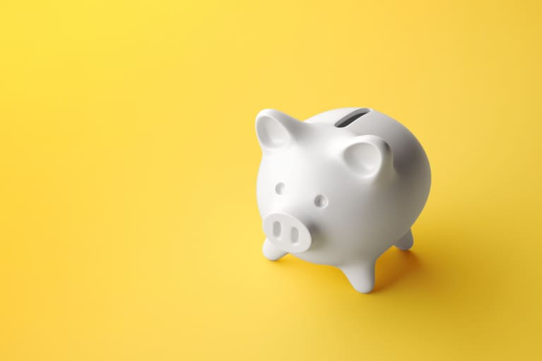 white piggy bank on yellow background