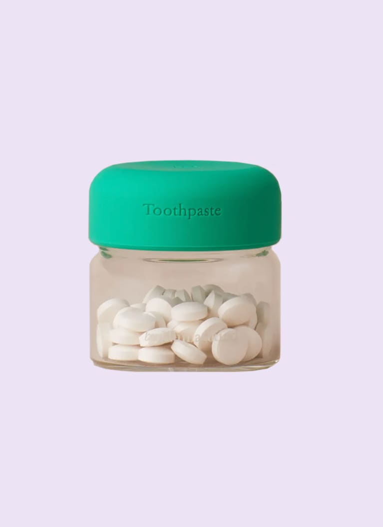 byHumankind toothpaste tablets in a jar with a green lid