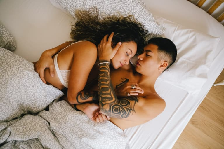 Couple Embracing in Bed