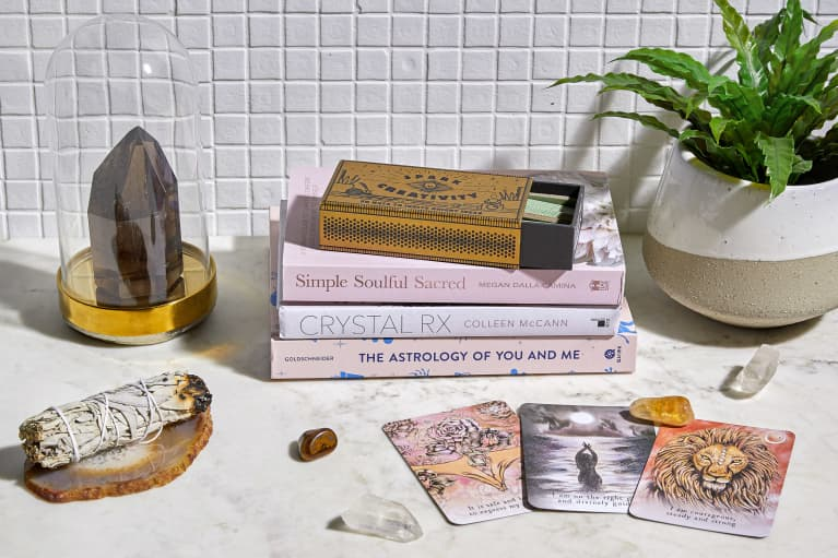 Oracle Cards, Crystals, and Books on a Countertop
